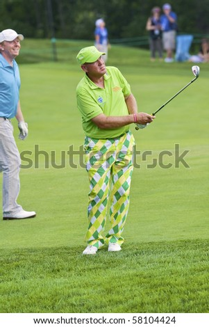 TORONTO, ONTARIO - JULY 21: US golfer John Daly during a pro-am event at the RBC Canadian Open golf, St. George's; Golf and Country Club July 21, 2010 in Toronto, Ontario - stock photo