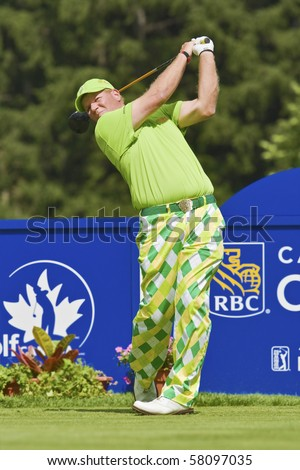 TORONTO, ONTARIO - JULY 21: US golfer John Daly follows his tee shot during a pro-am event at the RBC Canadian Open golf, St. George's, Golf and Country Club July 21, 2010 Toronto, Ontario. - stock photo