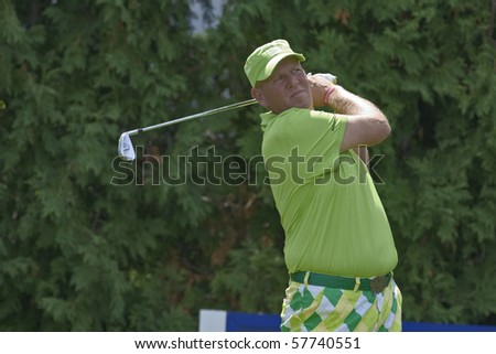 TORONTO, ONTARIO - JULY 21: US golfer John Daly tees off during a pro-am event at the RBC Canadian Open golf on July 21, 2010 on Toronto, Ontario. - stock photo