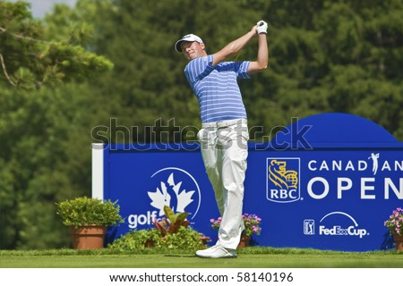 TORONTO, ONTARIO - JULY 21: US golfer Webb Simpson tees off during a pro-am event at the RBC Canadian Open golf, St. George's; Golf and Country Club on July 21, 2010 in Toronto, Ontario. - stock photo