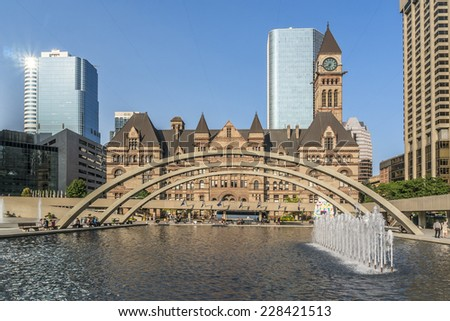 Toronto's Old City Hall (architect Edward James Lennox, 1899) was home to its city council from 1899 to 1966 and remains one of the city's most prominent structures. - stock photo
