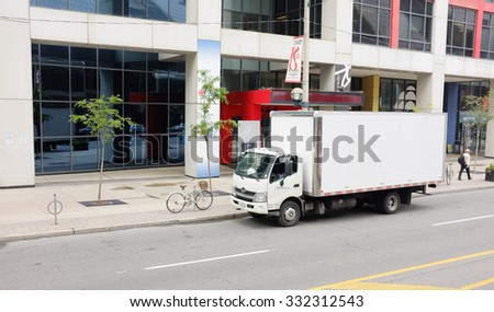 TORONTO, SEP. 29: White Delivery van truck parked in downtown Toronto, Canada taken on Sept. 29, 2015. - stock photo