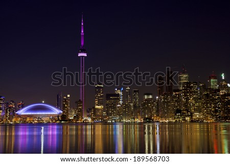 toronto skyline at night with reflection in lake - stock photo
