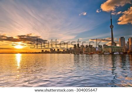 Toronto skyline at sunset in Ontario, Canada. - stock photo