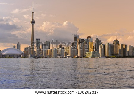 Toronto Skyline at sunset over lake Ontario with colorful sky - stock photo
