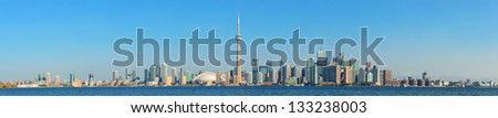 Toronto skyline panorama over lake with urban architecture. - stock photo