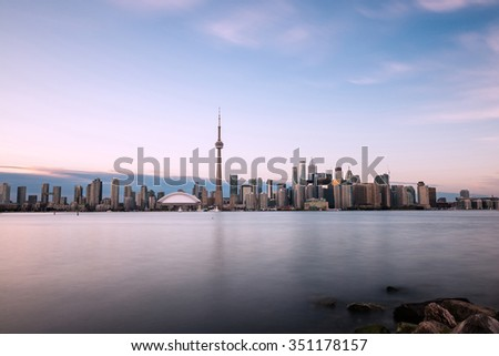 Toronto skyline with Lake Ontario in the foreground, as seen from Center Island. Long exposure. - stock photo