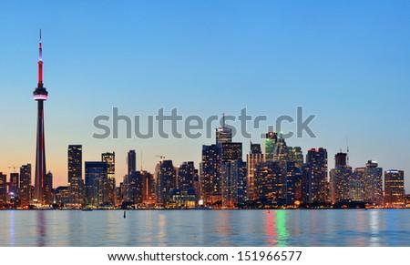 Toronto sunset over lake panorama with urban skyline. - stock photo