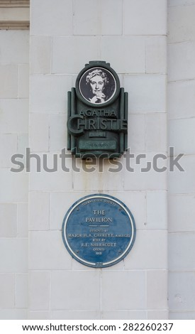 TORQUAY, ENGLAND - April 30, 2015: Agatha Christie Mile on the Wall of the Pavillion in Torquay, England. The Pavillion was Opened in 1912 - stock photo