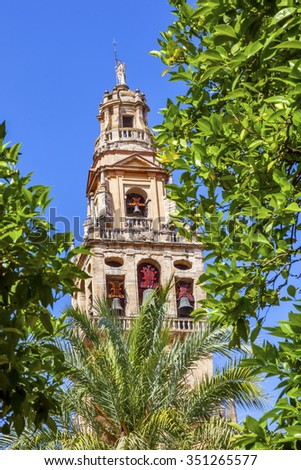 Torre del Alminar Bell Tower Spire Trees Palms Mezquita Cordoba Andalusia Spain.  Created in 785 as a Mosque, was converted to a Cathedral in the 1500.  Bell Tower was constructed on top of minaret.  - stock photo