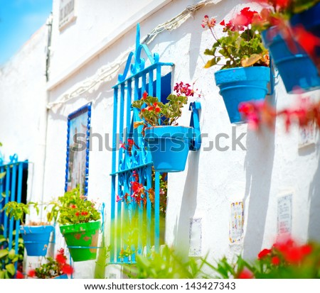 Torremolinos. Costa del Sol, Andalucia. Typical White Village with flower pots in facades at Spain - stock photo