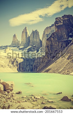 Torres del Paine mountains and lake, Chile, retro vintage filtered. - stock photo