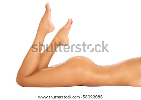 Torso, bum and legs of slim tanned sexy naked woman lying on white background - stock photo