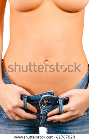 Torso of a girl in blue jeans - stock photo