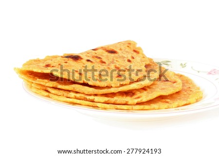 tortilla chapati paratha or indian bread closeup in pure white background - stock photo