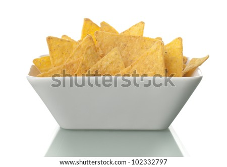 tortilla chips in white bowl - stock photo