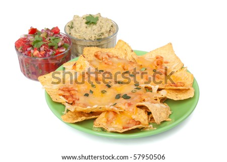Tortilla chips with melted cheddar, beans, hot salsa and guacamole - stock photo