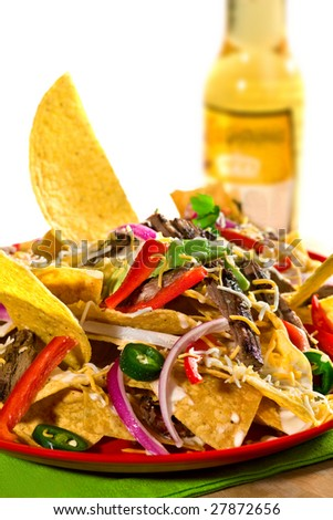 tortilla chips with salad and isolated on white with fresh beer on the background - stock photo