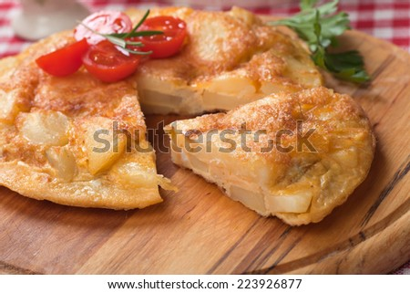 Tortilla, spanish omelet with fried potato and vegetables - stock photo