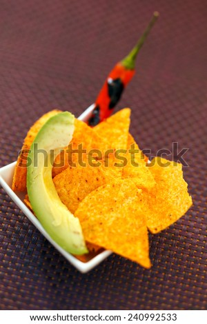 tortilla with chili and avocado - stock photo