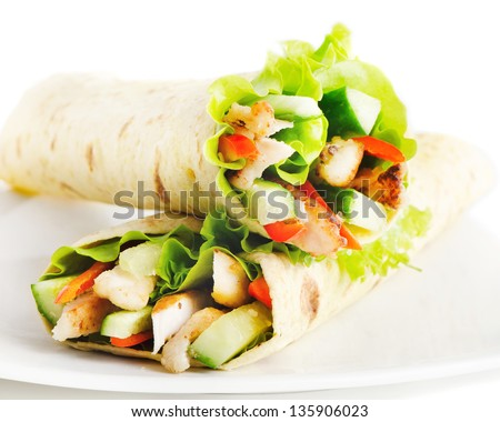 tortilla wraps with chicken and fresh vegetables isolated on white - stock photo