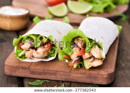 Tortilla wraps with chicken meat and vegetables - stock photo