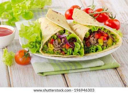 tortilla wraps with meat and vegetables. Selective focus - stock photo
