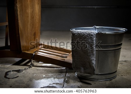Torture chamber with a water bucket for controversial waterboarding.   - stock photo