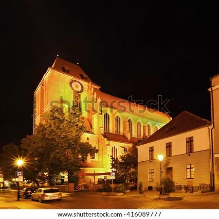 TORUN, POLAND - JUNE 12: Night streets of old Town in Torun city on June 12, 2011. Torun is an old historic town and UNESCO World Heritage Site - stock photo