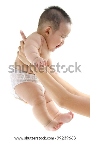 Tossing playful Asian baby on white background - stock photo