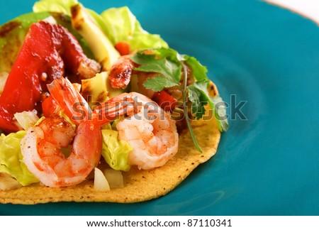 tostadas on blue plate - stock photo