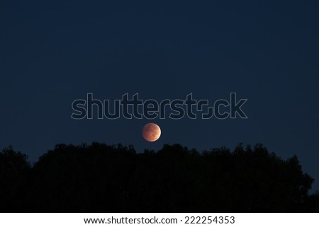 Total lunar eclipse on October 8, 2014 - stock photo