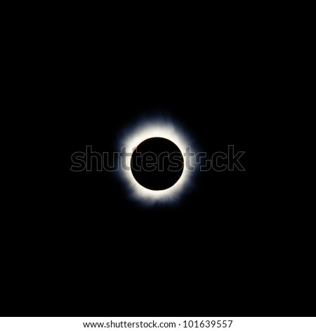 Total solar eclipse with the moon obscuring the disc of the sun so that only the corona is visible as a bright ring - stock photo