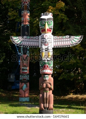 Totem pole in Stanley Park, Vancouver. - stock photo