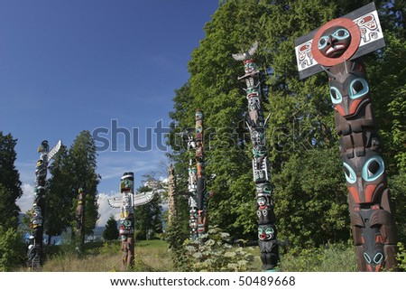 Totems in Stanley Park, vancouver - stock photo