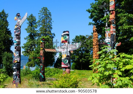 Totems in Stanley Park Vancouver, Canada - stock photo