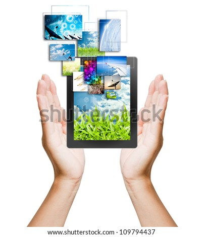 touch pad PC and streaming images buttons on women hand on background white - stock photo