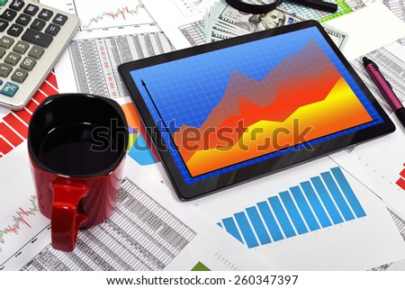 touch pad with forex chart on the table businessman - stock photo