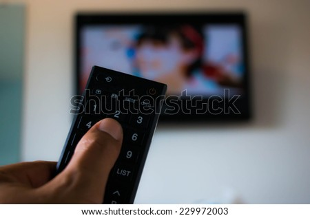 Touch remote control television - stock photo