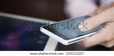 touch screen, close-up,  small depth of field, soft focus - stock photo