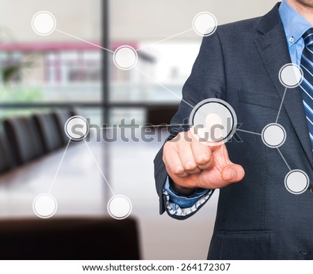 Touch screen concept. Businessman push diagram button. Isolated on office background - Stock Image - stock photo