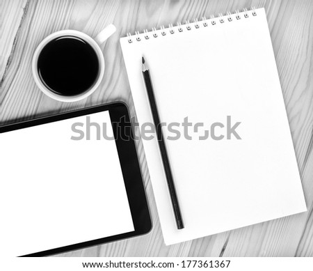 Touch screen device, notepad,  cup of coffee on wood - stock photo