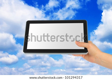 Touch screen device with blue sky in woman hand on white background - stock photo