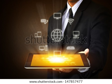 Touch screen tablet with cloud of  application icons - stock photo