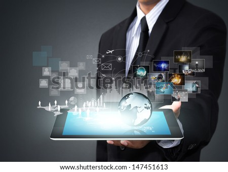 Touch screen tablet with new technology in male hand - stock photo