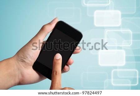 touch screen to smart phone with social network background. - stock photo