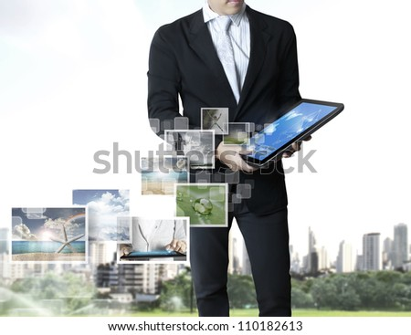 touch screen ,touch- tablet in hand - stock photo