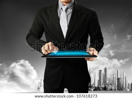 touch-tablet in hands with businessman - stock photo