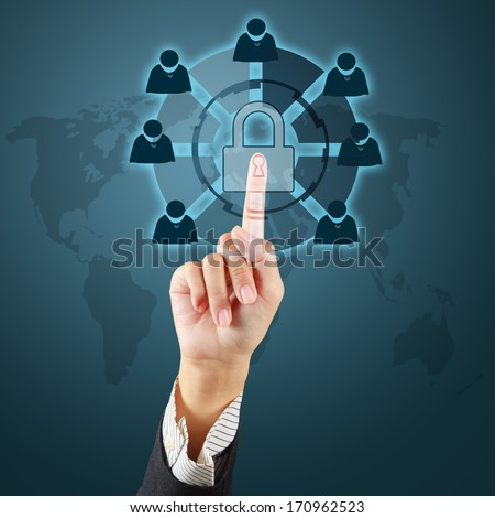 Touching a security key on virtual screen - stock photo