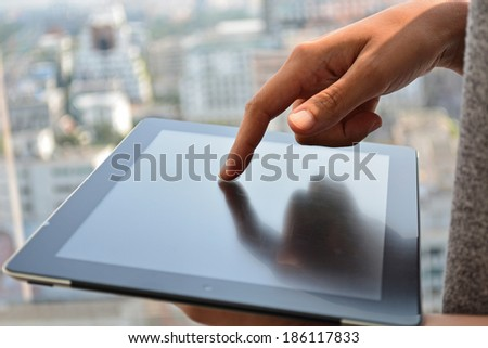 touching screen of a tablet computer - stock photo